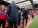 Manchester United manager Jose Mourinho and Manchester City boss Pep Guardiola shake hands before the derby at Old Trafford on September 10, 2016