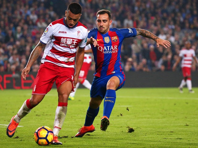 Barcelona's Paco Alcacer challenges Ruben Vezo of Granada during the La Liga clash at the Camp Nou on October 29, 2016