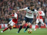 Tottenham Hotspur defender Jan Vertonghen evades Arsenal's Theo Walcott during the North London derby at the Emirates Stadium on November 6, 2016