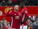 Wayne Rooney has a word with Paul Pogba during the Premier League game between Manchester United and Arsenal on November 19, 2016