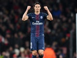 Edinson Cavani celebrates scoring during the Champions League game between Arsenal and PSG on November 23, 2016