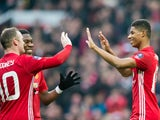 Manchester United forward Marcus Rashford celebrates with Wayne Rooney and Anthony Martial after scoring during the FA Cup third round clash with Reading at Old Trafford on January 7, 2017