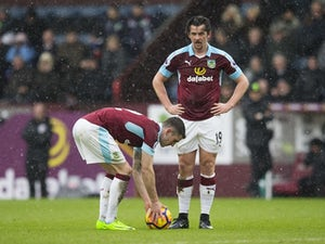 Robbie Brady and Joey Barton in the Premier League match between Burnley and Chelsea on February 12, 2017