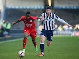 Leicester City's Ahmed Musa and Millwall's Calum Butcher on February 18, 2017