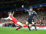 Shkodran Mustafi slides in Robert Lewandowski during the Champions League game between Arsenal and Bayern Munich on March 7, 2017