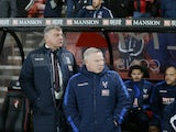 Crystal Palace manager Sam Allardyce watches on with assistant Sammy Lee during his side's Premier League clash with Bournemouth at the Vitality Stadium on January 31, 2017