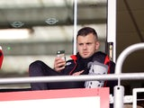 Jack Wilshere sits with his leg in a protective brace ahead of the Premier League game between Bournemouth and Stoke City on May 6, 2017