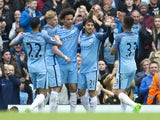 David Silva celebrates with teammates after scoring during the Premier League game between Manchester City and Leicester City on May 13, 2017