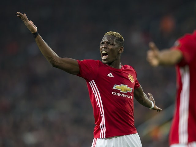 Manchester United's Paul Pogba reacts after a missed opportunity against Celta Vigo on May 11, 2017