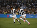 Juventus's Davi Alves celebrates scoring during the Coppa Italia final against Lazio on May 17, 2017