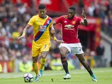 Patrick van Aanholt and Timothy Fosu-Mensah in action during the Premier League game between Manchester United and Crystal Palace on May 21, 2017