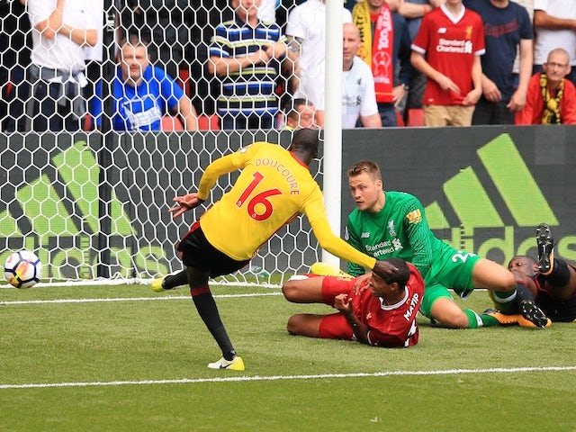 Abdoulaye Doucoure scores his side's second during the Premier League game between Watford and Liverpool on August 12, 2017