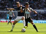 Ben Davies and Ayoze Perez in action during the Premier League game between Newcastle United and Tottenham Hotspur on August 13, 2017