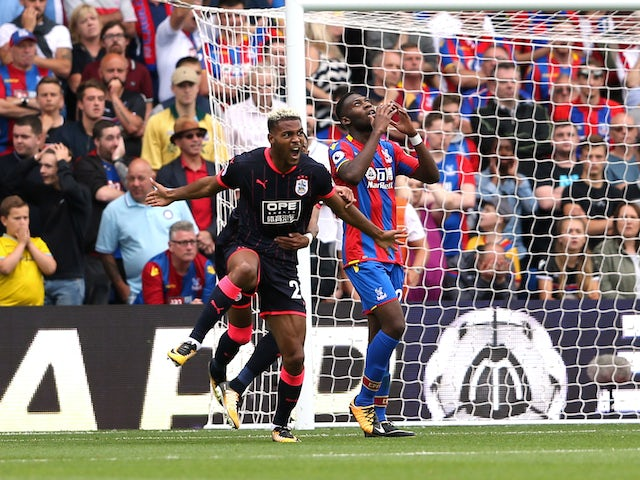 Steve Mounie celebrates scoring during the Premier League game between Crystal Palace and Huddersfield Town on August 12, 2017