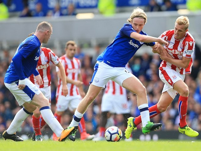 Tom Davies battles with Darren Fletcher during the Premier League game between Everton and Stoke City on August 12, 2017