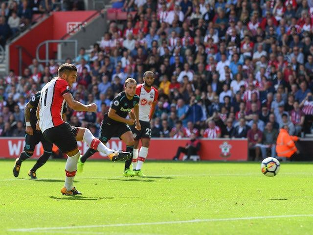 Dusan Tadic scores from the spot during the Premier League game between Southampton and West Ham United on August 19, 2017