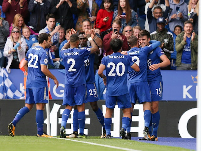 Harry Maguire celebrates with teammates after scoring during the Premier League game between Leicester City and Brighton & Hove Albion on August 19, 2017