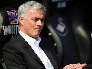 Mourinho plays down Liverpool clash