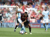 Joshua King attempts to manhandle Kevin De Bruyne during the Premier League game between Bournemouth and Manchester City on August 26, 2017