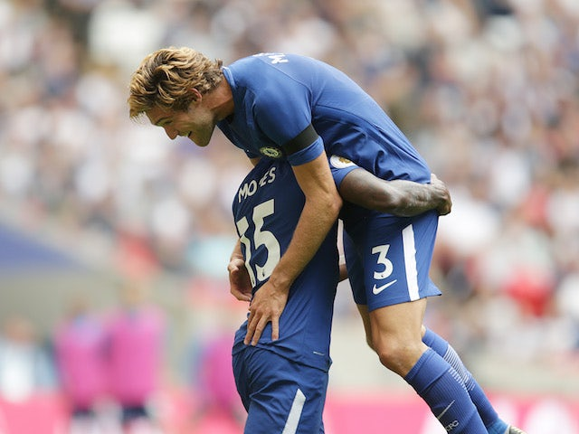 Marcos Alonso celebrates the opening goal during the Premier League game between Tottenham Hotspur and Chelsea on August 20, 2017