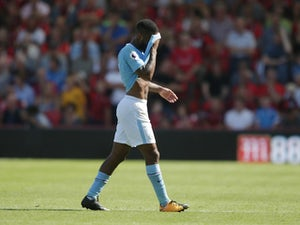 Raheem Sterling walks off after seeing red during the Premier League game between Bournemouth and Manchester City on August 26, 2017