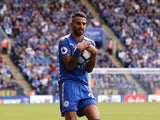 Riyad Mahrez clutches the ball during the Premier League game between Leicester City and Brighton & Hove Albion on August 19, 2017