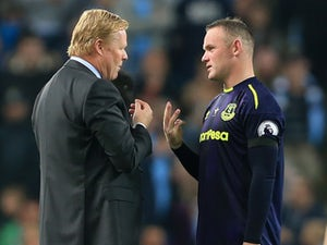 Ronald Koeman chats to Wayne Rooney during the Premier League game between Manchester City and Everton on August 21, 2017