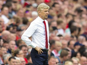 Arsene Wenger watches on during the Premier League game between Liverpool and Arsenal on August 27, 2017
