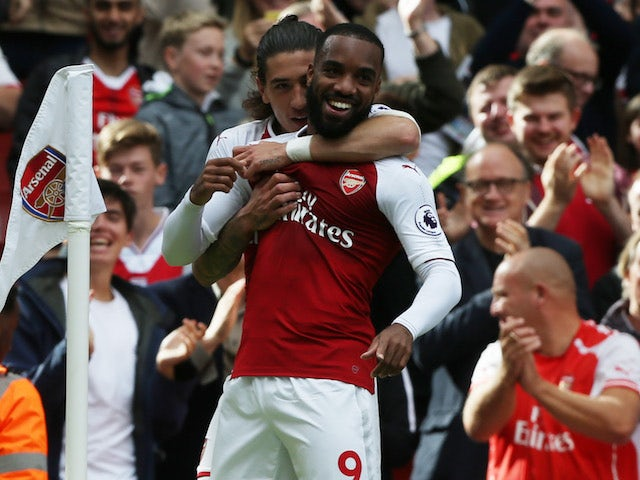 Alexandre Lacazette is congratulated by Hector Bellerin after scoring during the Premier League game between Arsenal and Bournemouth on September 9, 2017