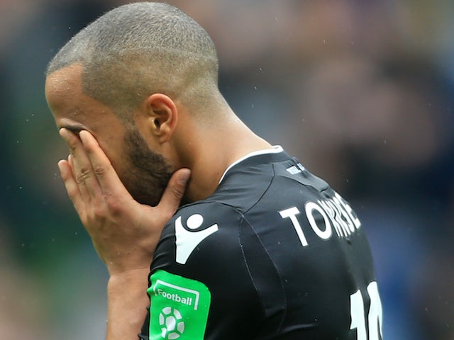 Andros Townsend dries his eyes during the Premier League game between Burnley and Crystal Palace on September 10, 2017