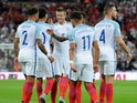 Eric Dier celebrates with teammates after scoring during the World Cup qualifier between England and Slovakia on September 4, 2017