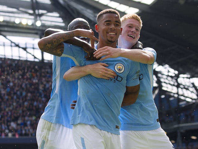 Gabriel Jesus celebrates with Kevin De Bruyne after scoring during the Premier League game between Manchester City and Liverpool on September 9, 2017