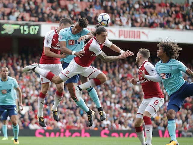 Hector Bellerin clears from Tyrone Mings during the Premier League game between Arsenal and Bournemouth on September 9, 2017