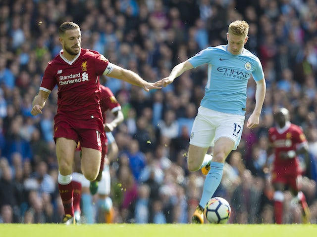 Jordan Henderson and Kevin De Bruyne in action during the Premier League game between Manchester City and Liverpool on September 9, 2017