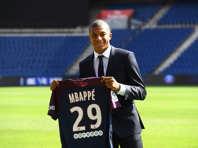 Kylian Mbappe poses with a Paris Saint-Germain shirt following his move from AS Monaco