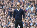 Pep Guardiola watches on during the Premier League game between Manchester City and Liverpool on September 9, 2017