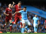 Roberto Firmino battles with Sergio Aguero during the Premier League game between Manchester City and Liverpool on September 9, 2017