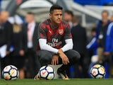 Alexis Sanchez squats ahead of the Premier League game between Chelsea and Arsenal on September 17, 2017
