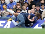 David Luiz takes out a photographer during the Premier League game between Chelsea and Arsenal on September 17, 2017