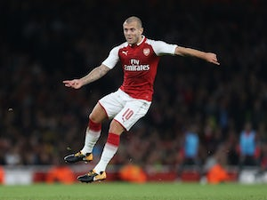 A shaven-headed Jack Wilshere in action during the EFL Cup game between Arsenal and Doncaster Rovers on September 20, 2017