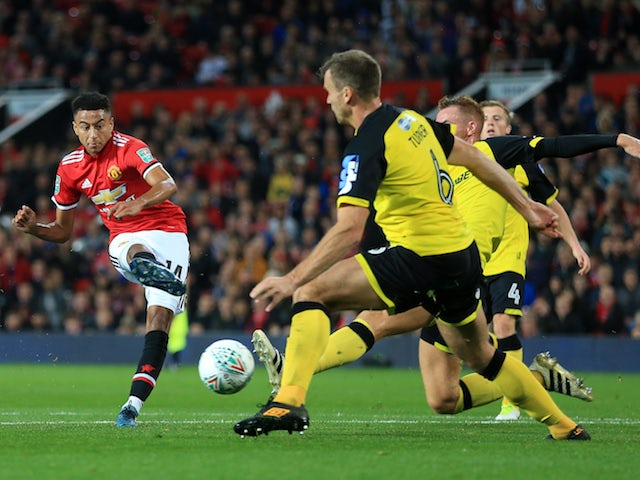 Jesse Lingard scores the third during the EFL Cup game between Manchester United and Burton Albion on September 20, 2017