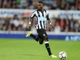 Christian Atsu in action for Newcastle United during their Premier League clash with Liverpool
