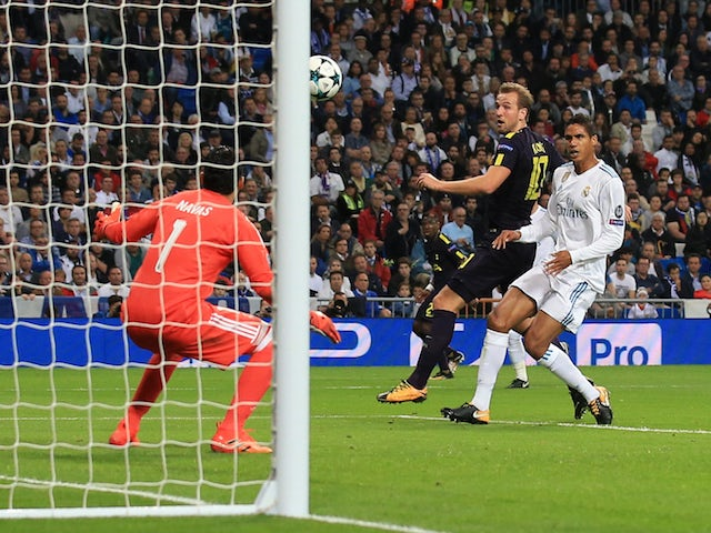 Harry Kane scores the opener during the Champions League group game between Real Madrid and Tottenham Hotspur on October 17, 2017