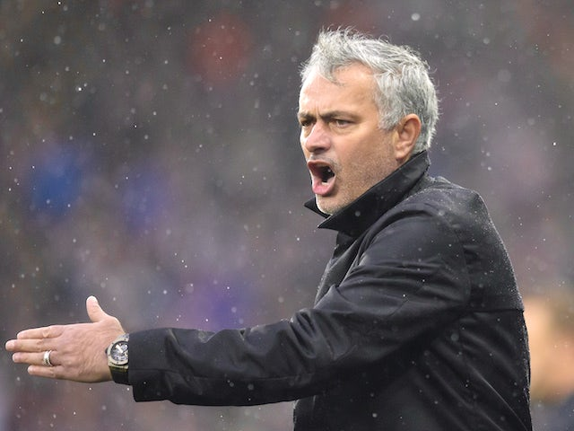 Jose Mourinho shouts during the Premier League game between Huddersfield Town and Manchester United on October 21, 2017