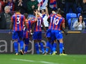 Wilfried Zaha celebrates with teammates after scoring during the Premier League game between Crystal Palace and Chelsea on October 14, 2017