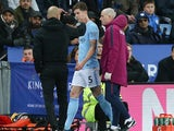 John Stones comes off injured during the Premier League game between Leicester City and Manchester City on November 18, 2017