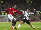 Paul Pogba and Isaac Hayden in action during the Premier League game between Manchester United and Newcastle United on November 18, 2017