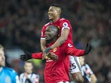 Romelu Lukaku celebrates scoring with Antonio Valencia during the Premier League game between Manchester United and Newcastle United on November 18, 2017