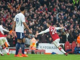 Shkodran Mustafi celebrates opening the scoring during the Premier League game between Arsenal and Tottenham Hotspur on November 18, 2017