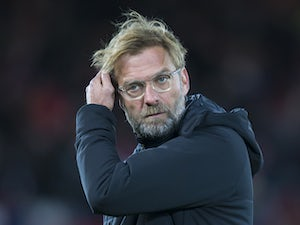 Dishevelled Reds boss Jurgen Klopp watches on during the Premier League game between Liverpool and Chelsea on November 25, 2017